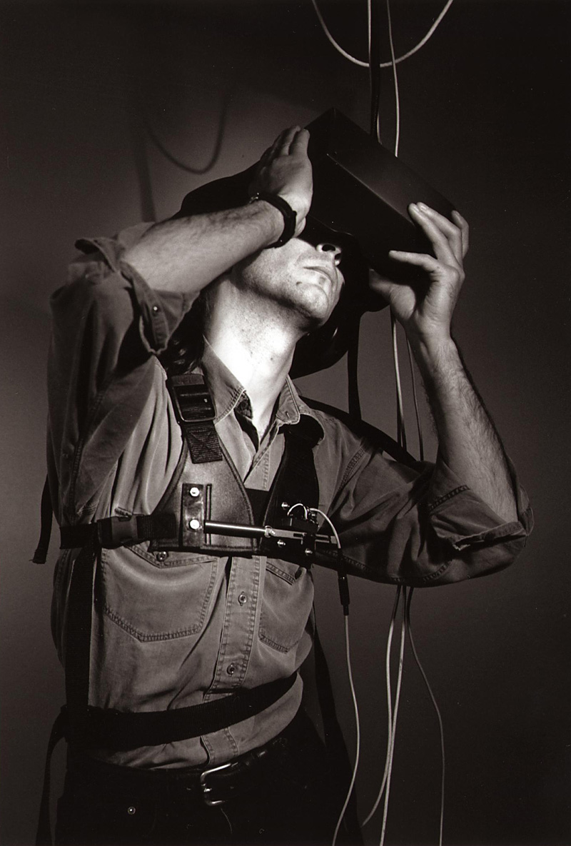 <strong>Figure 15.3 </strong>An &quot;immersant&quot; wearing stereoscopic head-mounted display and breathing/balance interface vest for a performance of Char Davies's Osmose (1995).