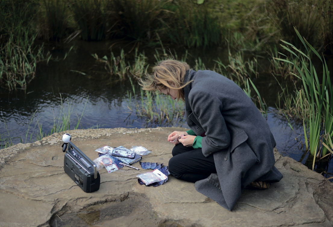 Katharine Vega at work on Of the Spheres, mixed reality performance at the Crawick Multiverse land art site by Charles Jencks, Dumfries and Galloway, 2017.